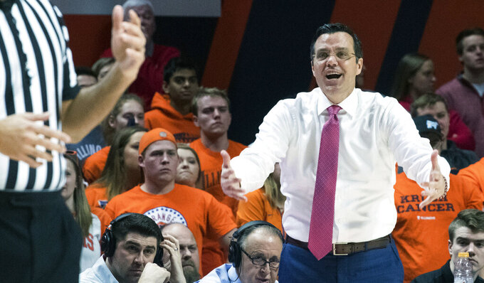 Nebraska head coach Tim Miles pleads his case to the referee during the first half of an NCAA college basketball game against Illinois in Champaign, Ill., Saturday. Feb. 2, 2019. (AP Photo/Robin Scholz)