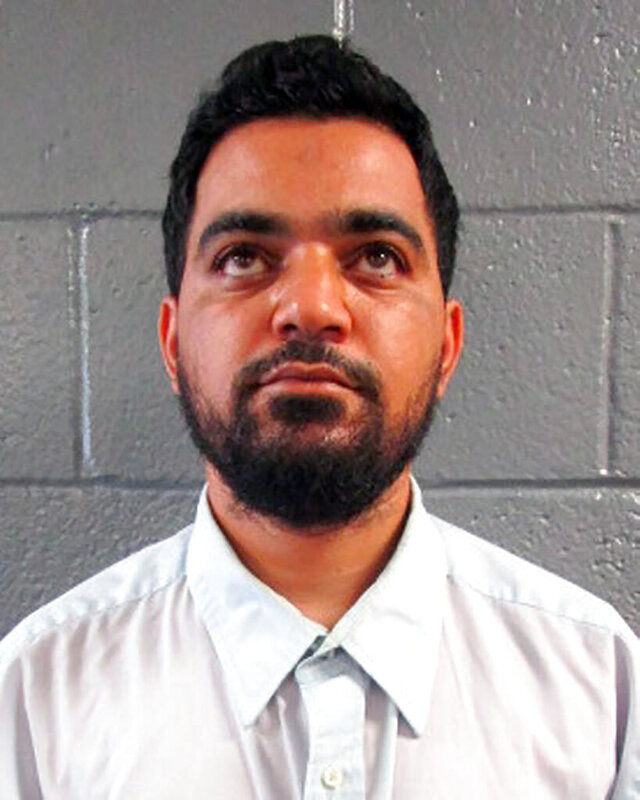 FILE - This undated file photo provided by the Arizona Department of Corrections shows Ahmad Suhad Ahmad, who was sentenced, Tuesday, Jan. 5 2021, in Tucson, to three years and five months in prison on convictions for heroin possession and distributing information related to explosives. (Arizona Department of Corrections via AP, File)
