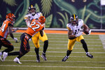 Pittsburgh Steelers' Chase Claypool (11) runs after a reception during the second half of an NFL football game against the Cincinnati Bengals, Monday, Dec. 21, 2020, in Cincinnati. (AP Photo/Bryan Woolston)