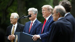 President Donald Trump speaks in the Rose Garden of the White House, Friday, May 29, 2020, in Washington, As White House trade adviser Peter Navarro, left, White House national security adviser Robert O'Brien, and White House chief economic adviser Larry Kudlow, far right, listen. (AP Photo/Alex Brandon)