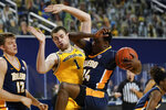 Michigan center Hunter Dickinson (1) defends Toledo guard Keshaun Saunders (24) in the second half of an NCAA college basketball game in Ann Arbor, Mich., Wednesday, Dec. 9, 2020. (AP Photo/Paul Sancya)