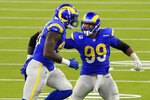 Los Angeles Rams defensive end Michael Brockers, left, celebrates his sack with Aaron Donald (99) during the second half of an NFL football game against the New England Patriots Thursday, Dec. 10, 2020, in Inglewood, Calif. (AP Photo/Jae C. Hong)