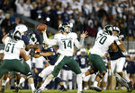 Michigan State quarterback Brian Lewerke (14) throws a pass against Penn State during the second half of an NCAA college football game in State College, Pa., Saturday, Oct. 13, 2018. (AP Photo/Chris Knight)