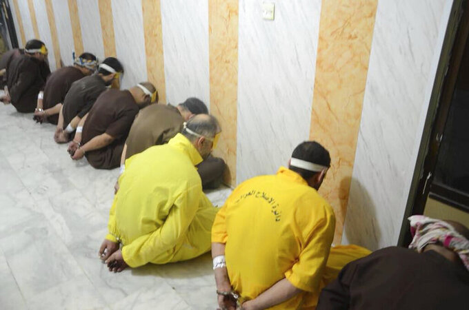 FILE - In this file photo released by Iraq's Ministry of Justice on June 29, 2018, blindfolded prisoners await their executions in Iraq. A report released by Amnesty International on Wednesday, April 21, 2021, said the number of executions worldwide in 2020 plummeted to its lowest level in at least a decade. But the report said four states in the Middle East — Iran, Egypt, Iraq and Saudi Arabia respectively — topped the global list and pressed on with shootings, beheadings and hangings, ignoring pleas by rights groups to halt executions during the pandemic. (Iraq Ministry of Justice via AP, File)