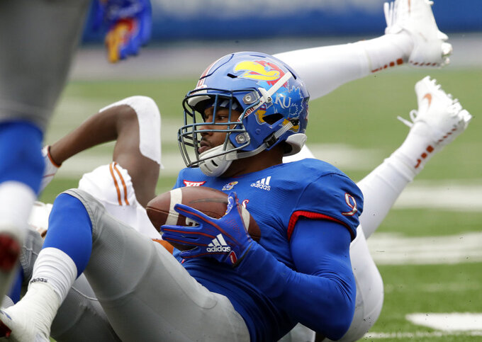 Kansas defensive end Najee Stevens-McKenzie (9) comes up with a pass interception during the first half of an NCAA college football game against Texas in Lawrence, Kan., Friday, Nov. 23, 2018. (AP Photo/Orlin Wagner)