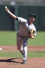 Colorado Rockies' Chi Chi González throws against the San Francisco Giants during the second inning of a baseball game in San Francisco, Thursday, Sept. 24, 2020. (AP Photo/Jed Jacobsohn)