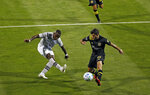 Columbus Crew's Milton Valenzuela, right, blocks the shot of Montreal Impact's Zachary Brault-Guillard (15) during the first half of an MLS soccer match in Columbus, Ohio, Wednesday, Oct. 7, 2020. (Kyle Robertson/The Columbus Dispatch via AP)