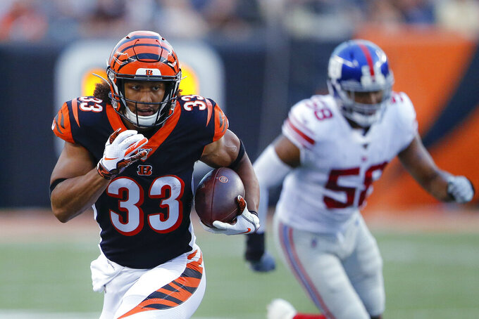 Cincinnati Bengals running back Rodney Anderson (33) runs the ball during the first half of the team's NFL preseason football game against the New York Giants, Thursday, Aug. 22, 2019, in Cincinnati. (AP Photo/Gary Landers)