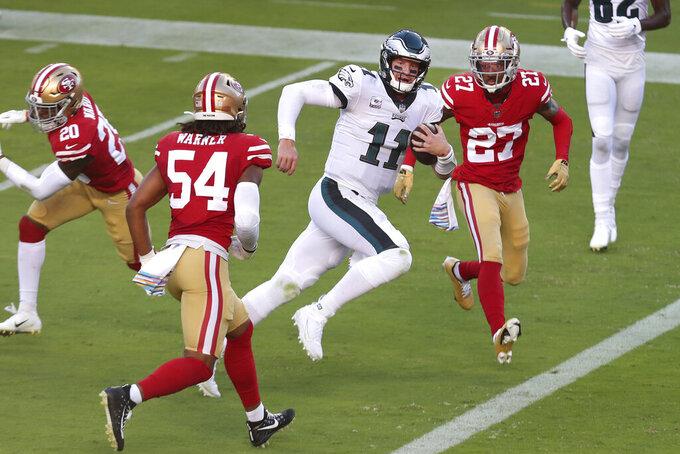 Philadelphia Eagles quarterback Carson Wentz (11) runs for a touchdown against the San Francisco 49ers during the first half of an NFL football game in Santa Clara, Calif., Sunday, Oct. 4, 2020. (AP Photo/Jed Jacobsohn)