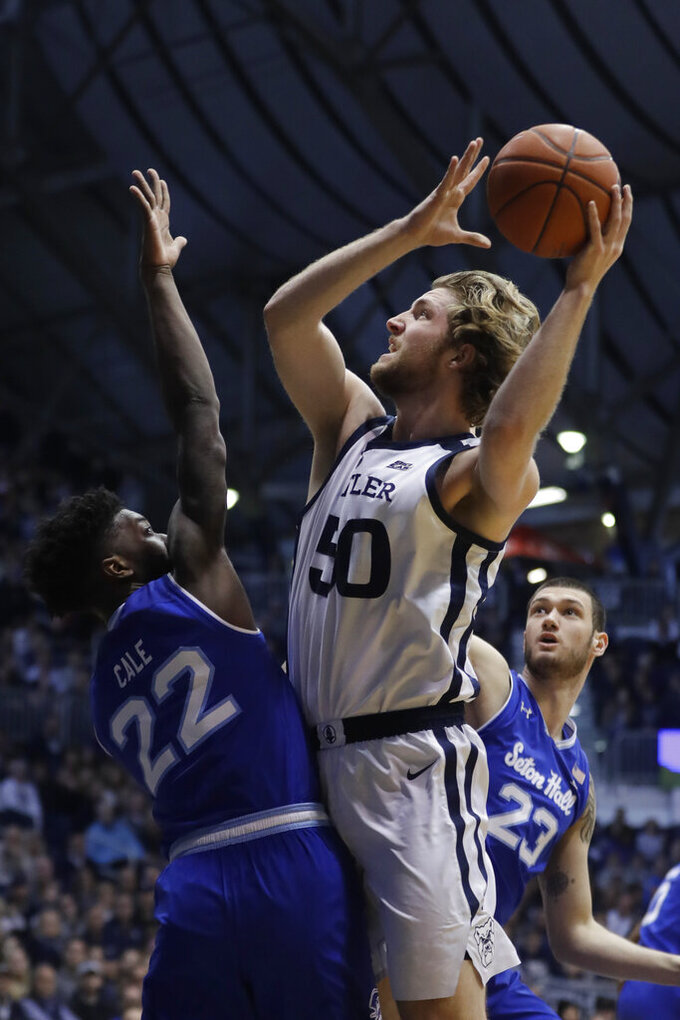 Butler's Joey Brunk (50) puts up a shot against Seton Hall's Myles Cale (22) during the first half of an NCAA college basketball game, Saturday, Feb. 2, 2019, in Indianapolis. (AP Photo/Darron Cummings)
