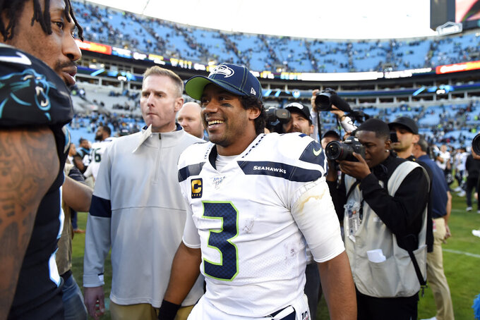 Seattle Seahawks quarterback Russell Wilson (3) reacts following an NFL football game against the Carolina Panthers in Charlotte, N.C., Sunday, Dec. 15, 2019. (AP Photo/Mike McCarn)