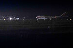 A charter flight transporting passengers from the quarantined Diamond Princess cruise ship arrives at Travis Air Force Base in Fairfield, Calif., Sunday, Feb. 16, 2020. (AP Photo/Hector Amezcua)