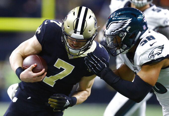 Philadelphia Eagles middle linebacker Jordan Hicks (58) hits New Orleans Saints quarterback Taysom Hill (7) in the first half of an NFL divisional playoff football game in New Orleans, Sunday, Jan. 13, 2019. (AP Photo/Butch Dill)