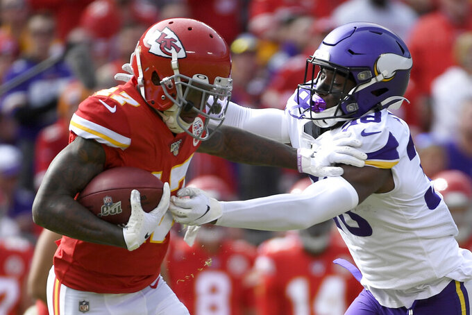 Minnesota Vikings cornerback Kris Boyd (38) tackles Kansas City Chiefs wide receiver Mecole Hardman (17) during the first half of an NFL football game in Kansas City, Mo., Sunday, Nov. 3, 2019. (AP Photo/Reed Hoffmann)
