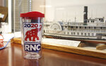A piece of RNC 2020 memorabilia displayed Thursday, Oct. 22, 2020, in Jacksonville, Fla., commemorates an event that never took place. Republican plans to hold part of its political convention in Jacksonville, in August were scuttled because of concerns over the coronavirus pandemic. (AP Photo/Bobby Caina Calvan)
