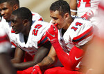 From left, Stony Brook defensive back Synceir Malone and Damarcus Miller and linebacker EJ Fineran sit on the bench late in the second half of an NCAA college football game Saturday, Sept. 1, 2018, at Air Force Academy, Colo. Air Force won 38-0. (AP Photo/David Zalubowski)