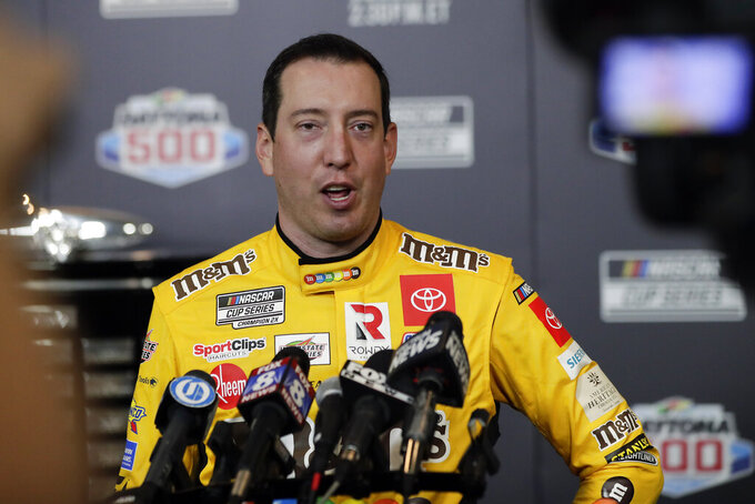 Kyle Busch answers questions during NASCAR Daytona 500 auto racing media day at Daytona International Speedway, Wednesday, Feb. 12, 2020, in Daytona Beach, Fla. (AP Photo/John Raoux)