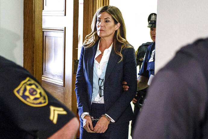 FILE - In this Oct. 24, 2016, file photo, former Pennsylvania Attorney General Kathleen Kane leaves court in handcuffs after her sentencing at the Montgomery County Courthouse in Norristown, Pa. Kane is set to be released from a county jail on Wednesday, July 31, 2019, after serving about eight months for leaking grand jury material and lying about it, Montgomery County Correctional Facility Warden Julio Algarin said. (Dan Gleiter/PennLive.com via AP, Pool, File)