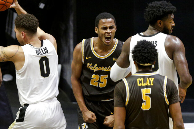Valparaiso guard Nick Robinson (25) reacts after a basket during the first half of an NCAA college basketball game against Purdue, Friday, Dec. 4, 2020, in West Lafayette, Ind. (Nikos Frazier/Journal & Courier via AP)