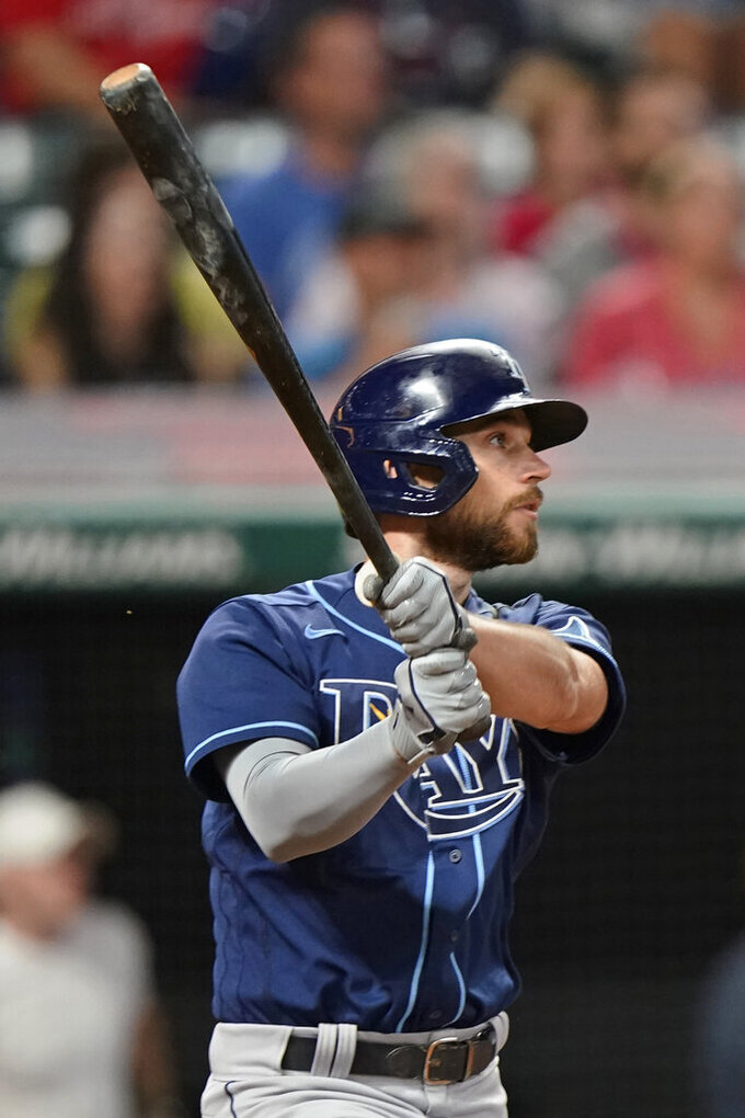 Tampa Bay Rays' Brandon Lowe watches his RBI double in the ninth inning of the team's baseball game against the Cleveland Indians, Thursday, July 22, 2021, in Cleveland. Tampa won 5-4 in 10 innings. (AP Photo/Tony Dejak)