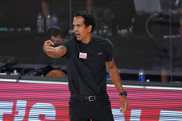 Miami Heat head coach Erik Spoelstra instructs his team during the first half of an NBA conference final playoff basketball game against the Boston Celtics on Tuesday, Sept. 15, 2020, in Lake Buena Vista, Fla. (AP Photo/Mark J. Terrill)