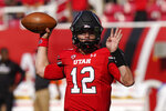 Utah quarterback Charlie Brewer warms up for the team's NCAA college football game against Weber State on Thursday, Sept. 2, 2021, in Salt Lake City. (AP Photo/Rick Bowmer)