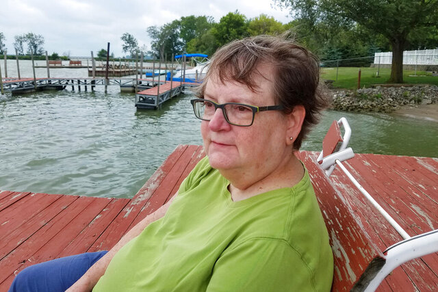 In this August 2017 photo, Associated Press journalist Mark Gillispie's wife, Mary Lou Gillispie, sits for a photo in Marblehead, Ohio. Mary Lou died from cancer in late April 2020. (AP Photo/Mark Gillispie)