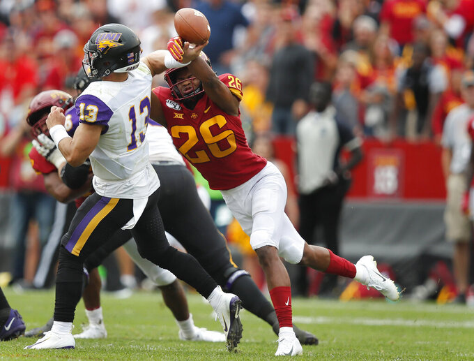 Iowa State defensive back Anthony Johnson, right, blocks a pass by Northern Iowa quarterback Will McElvain during the first half of an NCAA college football game, Saturday, Aug. 31, 2019, in Ames. (AP Photo/Matthew Putney)