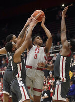 Stanford forward KZ Okpala (0) shoots between Washington State defenders during the first half of an NCAA college basketball game in Stanford, Calif., Thursday, Feb. 28, 2019. (AP Photo/Jeff Chiu)