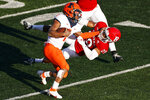Illinois quarterback Isaiah Williams knocks Rutgers defensive back Lawrence Stevens (29) to the ground during the second half of an NCAA college football game, Saturday, Nov. 14, 2020, in Piscataway, N.J. (AP Photo/Adam Hunger)