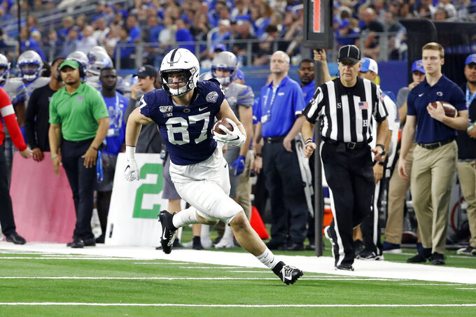 FILE - In this Dec. 28, 2019, file photo, Penn State tight end Pat Freiermuth (87) runs with the ball after a catch during the first half of the NCAA Cotton Bowl college football game against Memphis in Arlington, Texas.  Freiermuth was selected to The Associated Press preseason All-America first-team, Tuesday, Aug. 25, 2020. (AP Photo/Roger Steinman, File)