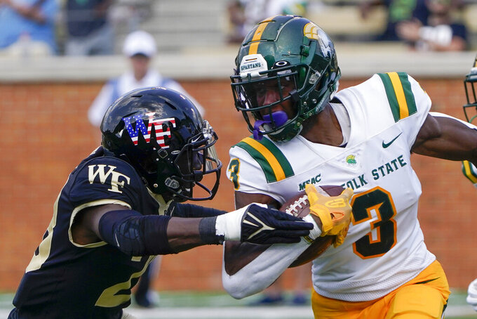 Norfolk State wide receiver Justin Smith runs past Wake Forest defensive back Zion Keith during the second half of a NCAA college football game Saturday, Sept. 11, 2021, in Winston-Salem, N.C. (AP Photo/Chris Carlson)