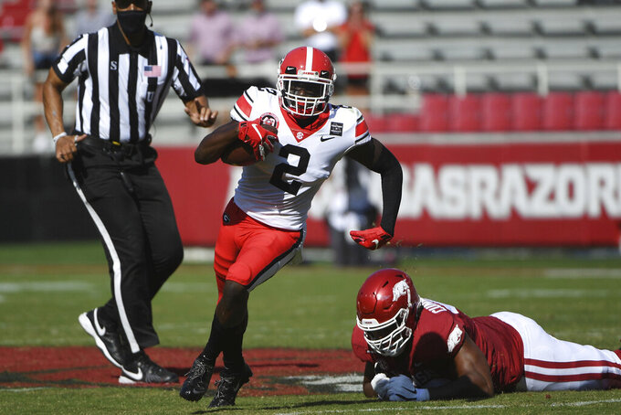 Georgia defensive back Richard LeCounte (2) returns an interception against Arkansas during the first half of an NCAA college football game in Fayetteville, Ark.,  Saturday, Sept. 26, 2020. Just in time for a key SEC East game against No. 8 Florida, No. 5 Georgia has to adjust to a rash of new injuries on defense after a rough weekend capped by safety Richard LeCounte avoiding life-threatening injuries in an accident while riding his motorcycle. (AP Photo/Michael Woods, File)