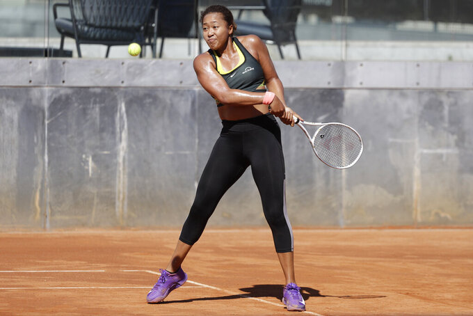 Japan's Naomi Osaka returns the ball during a training session at the Italian Open tennis tournament, in Rome, Monday, May 10, 2021. (AP Photo/Gregorio Borgia)