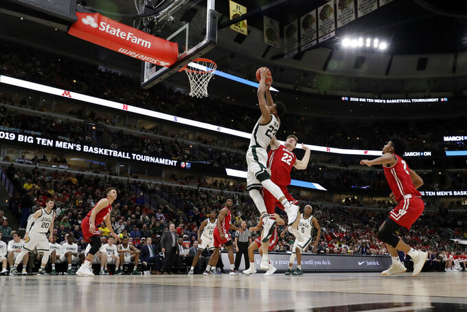 Michigan State's Xavier Tillman (23) grabs a rebound over Wisconsin's Ethan Happ (22) during the second half of an NCAA college basketball game in the semifinals of the Big Ten Conference tournament, Saturday, March 16, 2019, in Chicago. (AP Photo/Nam Y. Huh)