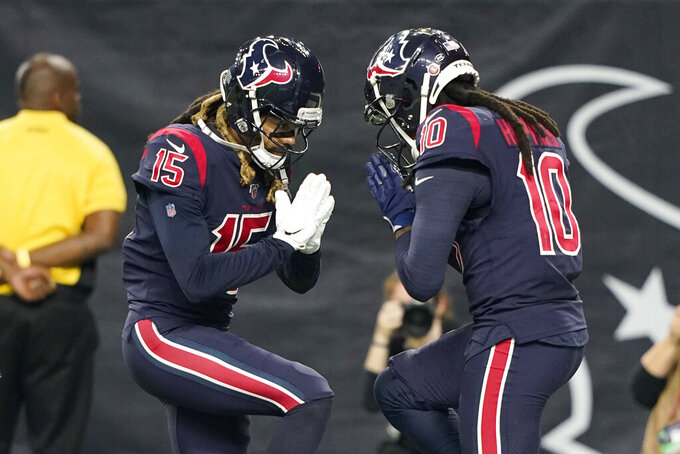Houston Texans wide receiver DeAndre Hopkins (10) celebrates his touchdown catch against the Indianapolis Colts with teammate Will Fuller (15) during the first half of an NFL football game Thursday, Nov. 21, 2019, in Houston. (AP Photo/David J. Phillip)