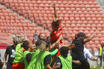 Houston Dash's Shea Groom, top, celebrates with teammates after scoring against the Chicago Red Stars during the second half of an NWSL Challenge Cup soccer finals match Sunday, July 26, 2020, in Sandy, Utah. (AP Photo/Rick Bowmer)