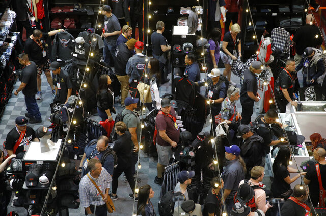 FILE - In this Nov. 5, 2019 file photo, people shop in a store at the SEMA show, an automotive specialty products convention in Las Vegas. Casino gambling remained slow in Nevada last month, according to a key index of casino activity that showed little improvement from the month before. The Nevada Gaming Control Board said Wednesday, Sept. 30, 2020 that casino house winnings of $743 million statewide were down 22% in August, compared with the same month a year ago when casinos reported winning nearly $954 million in August 2019.  (AP Photo/John Locher, File)