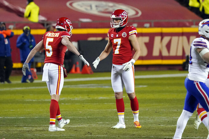 Kansas City Chiefs place kicker Harrison Butker (7) celebrates with teammate Tommy Townsend (5) after kicking a 45-yard field goal during the second half of the AFC championship NFL football game against the Buffalo Bills, Sunday, Jan. 24, 2021, in Kansas City, Mo. (AP Photo/Jeff Roberson)