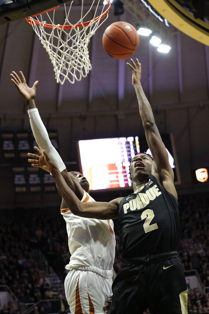 Purdue guard Eric Hunter Jr., right, shoots around Texas guard Andrew Jones in the second half of an NCAA college basketball game in West Lafayette, Ind., Saturday, Nov. 9, 2019. Texas won 70-66. (AP Photo/AJ Mast)
