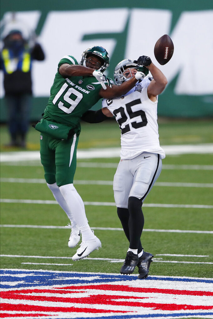 Las Vegas Raiders' Erik Harris, right, breaks up a pass intended for New York Jets' Breshad Perriman during the second half an NFL football game, Sunday, Dec. 6, 2020, in East Rutherford, N.J. (AP Photo/Noah K. Murray)