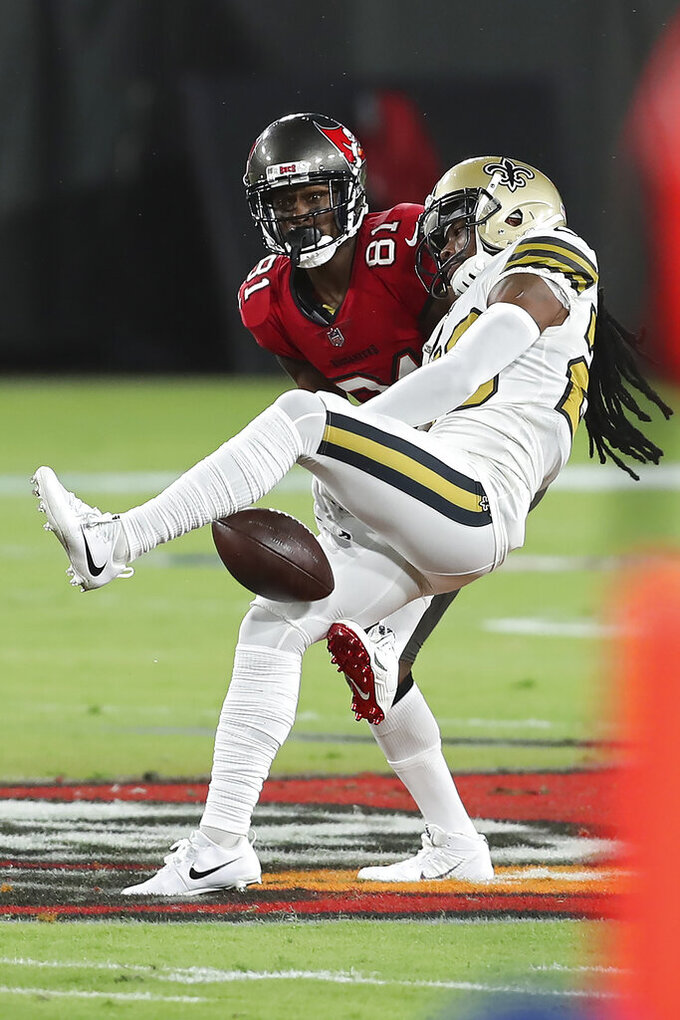 New Orleans Saints cornerback Janoris Jenkins (20) breaks up a pass intended for Tampa Bay Buccaneers wide receiver Antonio Brown (81) during the first half of an NFL football game Sunday, Nov. 8, 2020, in Tampa, Fla. (AP Photo/Mark LoMoglio)