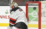 The puck bounces off the cross bar on a shot by Los Angeles Kings defenseman Jake Muzzin as New Jersey Devils goaltender Keith Kinkaid looks the other way during the second period of an NHL hockey game Thursday, Dec. 6, 2018, in Los Angeles. (AP Photo/Mark J. Terrill)