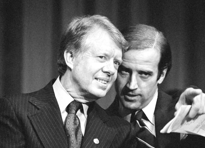 FILE - In this Feb. 20, 1978, file photo, President Jimmy Carter listens to Sen. Joseph R. Biden, D-Del., as they wait to speak at fund raising reception at Padua Academy in Wilmington, Del. (AP Photo/Barry Thumma, File)