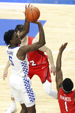 Kentucky's Terrence Clarke, left, shoots near Richmond's Blake Francis (1) during the second half of an NCAA college basketball game in Lexington, Ky., Sunday, Nov. 29, 2020. (AP Photo/James Crisp)