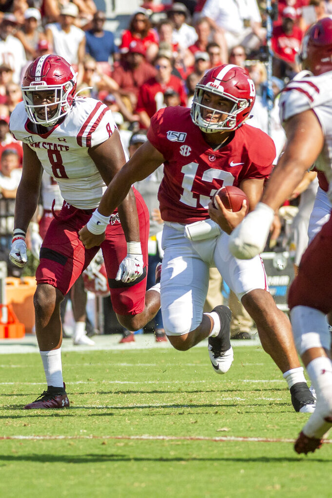 Alabama quarterback Tua Tagovailoa (13) takes off for a running touchdown during the first half of an NCAA college football game against New Mexico State, Saturday, Sept. 7, 2019, in Tuscaloosa, Ala. (AP Photo/Vasha Hunt)