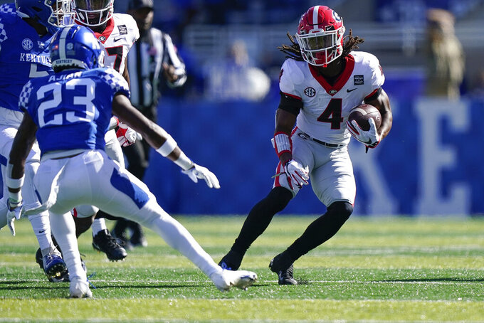 Georgia running back James Cook (4) runs with the ball during the first half of an NCAA college football game against Kentucky, Oct. 31, 2020, in Lexington, Ky. (AP Photo/Bryan Woolston)