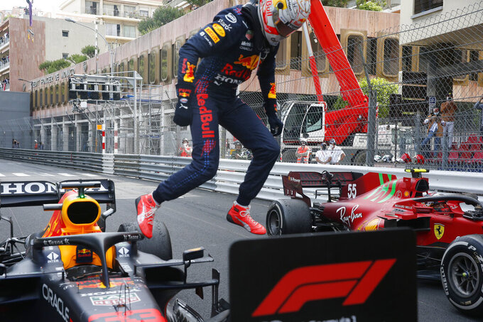 Red Bull driver Max Verstappen of the Netherlands jumps out of his car after winning the Monaco Grand Prix at the Monaco racetrack, in Monaco, Sunday, May 23, 2021. (Sebastien Nogier, Pool via AP)