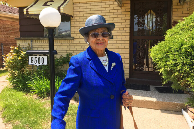In this photo provided by Gregory A. Clark, Catherine S. Clark, cousin of Kimberly Montgomery who died Feb. 9, 2020, at the age of 94 from COVID-19, poses for a photo in Chicago. Catherine S. Clark was one of 15 people who died of COVID-19 in the life of Montgomery. (Gregory A. Clark via AP)