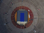 Workers transform the Plaza de Toros Mexico bullring to host an upcoming exhibition tennis match between Roger Federer and Alexander Zverev, in Mexico City, Thursday, Nov. 21, 2019.  The venue, recognized as the largest bullring in the world, was chosen for the event because it can seat more than 40,000. (AP Photo/Rebecca Blackwell)
